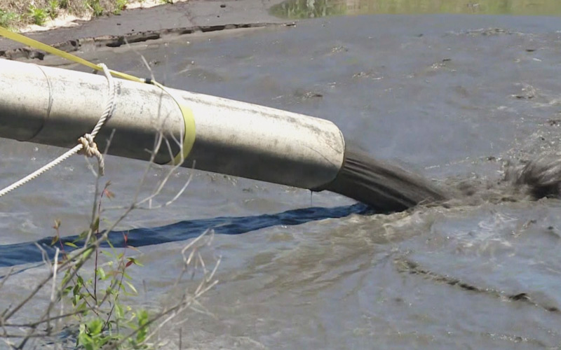 Dredge Spoil Pumped out of River