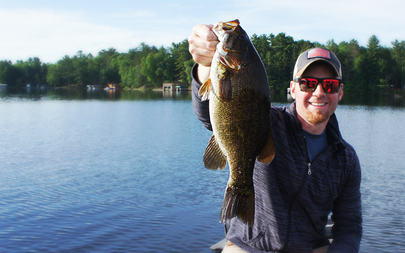 AJ Hauser with an Early Morning Football Smallmouth