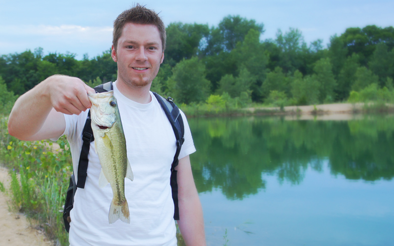 AJ Hauser with a Golden Pit Largemouth Bass