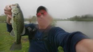 Largemouth Bass AJ Hauser in the Rain Strike King Ocho