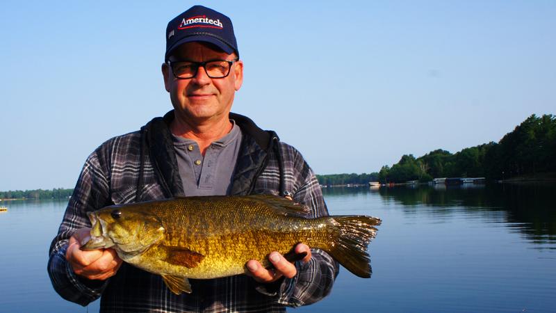 dad big smallmouth wisconsin fishing manitowish chain o lakes